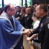 Father Dan J. Letourneau shakes hands with Edmond Det. David Otwell during the Blue Mass, to honor officers who lost their life in the line of duty at the Catholic Parish of St. John the Baptist in Edmond Saturday, May 15, 2010. Photo by Doug Hoke, The Oklahoman