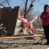 Tammy Woodyard, of Harveyville, surveys the wreckage of her father\'s home the morning after a tornado hit the town, Wednesday, Feb. 29, 2012, in Harveyville, Kan. Her father was unhurt. (AP Photo/John Hanna) ORG XMIT: RPJH103