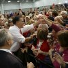 FILE - This Nov. 1, 2012 file photo shows Republican presidential candidate, former Massachusetts Gov. Mitt Romney greeting supporters at a campaign stop at Meadow Event Park in Richmond, Va. Romney calls it the