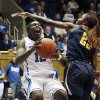 Duke\'s Chelsea Gray (12) drives to the basket against California\'s Gennifer Brandon (25) during the second half of an NCAA women\'s college basketball game in Durham, N.C., Sunday, Dec. 2, 2012. Duke won 77-63. (AP Photo/Gerry Broome)