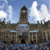 Photo - Crowds gather outside of Manchester's Town Hall as Manchester City supporters prepare to celebrate with a parade in the city centre the day after their team won the English Premier League soccer title in Manchester, England, Monday May 12, 2014. (AP Photo/Jon Super)