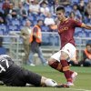 Atalanta goalkeeper Andrea Consigli, on the ground, grabs the ball as AS Roma forward Erik Lamela, of Argentina, challenges him during a Serie A soccer match between AS Roma and Atalanta, at Rome\'s Olympic stadium, Sunday, Oct. 7, 2012. (AP Photo/Riccardo De Luca)