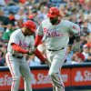 Photo -   Philadelphia Phillies' Ryan Howard (6) celebrates with Phillies third base coach Juan Samuel, left, as he rounds the bases after hitting a solo home run against the Atlanta Braves during the second inning of a baseball game Friday, Aug. 31, 2012, at Turner Field in Atlanta. (AP Photo/Gregory Smith)