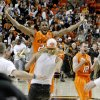 Oklahoma State\'s Michael Cobbins (20) and Keiton Page (12) celerbate as fans rush the court following an NCAA college basketball game between the Oklahoma State University Cowboys (OSU) and the Missouri Tigers (MU) at Gallagher-Iba Arena in Stillwater, Okla., Wednesday, Jan. 25, 2012. Oklahoma State won 79-72. Photo by Bryan Terry, The Oklahoman