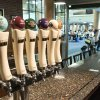 Photo - In this Sept. 11, 2013, photo, travelers walk past the Bell's beer pub that is scheduled to open soon inside the Gerald R. Ford Airport in Grand Rapids, Mich. Bell's beers on tap will be Midwestern Pale Ale, Kalamazoo Stout, Best Brown Ale, Two Hearted Ale, Amber Ale and Third Coast Pale Ale. Other domestic beers, liquor and wine also will be served. (AP Photo/MLive.com, Chris Clark)