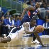 Photo - Orlando Magic shooting guard Victor Oladipo (5) passes to a teammate after gaining control of a loose ball in front of Atlanta Hawks point guard Shelvin Mack during the first half of an NBA basketball game in Orlando, Fla., Wednesday, Jan. 22, 2014. (AP Photo/Phelan M. Ebenhack)