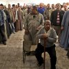 Egyptian men line up outside a polling station to cast their votes during a referendum on a disputed constitution drafted by Islamist supporters of President Morsi in Cairo, Egypt, Saturday, Dec. 15, 2012. (AP Photo/Khalil Hamra) ORG XMIT: KH127