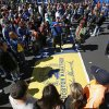 Photo - A large crowd gathers to pose for photos at the Boston Marathon finish line, one day before the race, Sunday, April 20, 2014, in Boston.  (AP Photo/Robert F. Bukaty)