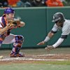 Clemson\'s Garrett Boulware, left, catches the ball as South Carolina\'s Shon Carson safely dives for the plate in an NCAA college baseball game on Friday, March 1, 2013, in Clemson, S.C. (AP Photo/Anderson Independent-Mail, Mark Crammer) GREENVILLE NEWS OUT, SENECA NEWS OUT