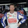 Driver Dale Earnhardt Jr. looks on from the garage area during practice for the AAA 400 NASCAR Sprint Cup Series auto race, Friday, Sept. 28, 2012, in Dover, Del. (AP Photo/Nick Wass)