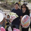 Actor Christian Bale and his wife Sibi Blazic carry flowers as they visit a memorial to the victims of Friday\'s mass shooting, Tuesday, July 24, 2012, in Aurora, Colo. Twelve people were killed when a gunman opened fire during a late-night showing of the movie