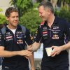 Photo - Red Bull driver Sebastian Vettel, left, of Germany is greeted by his crew member as he arrives at the paddock for a practice session ahead of the Malaysian Formula One Grand Prix at Sepang International Circuit in Sepang, Malaysia, Friday, March 28, 2014. (AP Photo/Peter Lim)