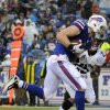 Buffalo Bills tight end Scott Chandler (84) catches a touchdown pass in front of Jacksonville Jaguars\' Dwight Lowery (25) during the first half of an NFL football game on Sunday, Dec. 2, 2012 in Orchard Park, N.Y. (AP Photo/Gary Wiepert)