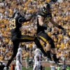 Missouri\'s Jerrell Jackson, left, congratulates teammate T.J. Moe on his 34-yard touchdown catch during the first half of an NCAA college football game against Oklahoma State Saturday, Oct. 22, 2011, in Columbia, Mo. (AP Photo/L.G. Patterson)