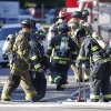 Firefighter work in front of an apartment where the suspect in a theatre shooting lived in Aurora, Colo., on Friday, July 20, 2012. As many as 12 people were killed and 50 injured at a shooting at the Century 16 movie theatre on Friday. The suspect is identified as 24-year-old James Holmes. (AP Photo/Ed Andrieski) ORG XMIT: COEA117