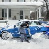 Photo - Donna Shade, left, Glenn Farrish, cetnter, and Fierah Thomas dig out a car after a winter snow storm Thursday, Feb. 13, 2013, in Winchester, Va. (AP Photo/The Winchester Star, Scott Mason)