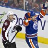 Colorado Avalanche\'s Erik Johnson (6) stands by as Edmonton Oilers\' Shawn Horcoff celebrates his goal during the second period of their NHL hockey game, Monday, Jan. 28, 2013, in Edmonton, Alberta. (AP Photo/The Canadian Press, Jason Franson)