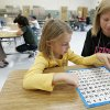 Katie Reeves (right) tutors first-grader Madelynn Langley at Clegern Elementary School in Edmond on Tuesday, Nov. 20, 2007. By John Clanton, The Oklahoman