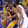Los Angeles\' Andrew Bynum drives against Oklahoma City\'s Kendrick Perkins and James Harden during Game 2 in the second round of the NBA playoffs between the Oklahoma City Thunder and the L.A. Lakers at Chesapeake Energy Arena on Wednesday, May 16, 2012, in Oklahoma City, Oklahoma. Photo by Chris Landsberger, The Oklahoman