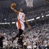 Photo - Toronto Raptors' DeMar DeRozan (10) goes up for a dunk as Brooklyn Nets' Paul Pierce (34) and Deron Williams (8) look on during the first half of Game 5 of the opening-round NBA basketball playoff series in Toronto, Wednesday, April 30, 2014. (AP Photo/The Canadian Press, Frank Gunn)