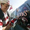 Bill Frank decorates a car during the Bevo Bash at the Carl\'s Jr. on Friday, Oct. 10, 2008, in Marietta, Okla. The University of Oklahoma Sooners will take on the Texas Longhorns in the Red River Rivalry Saturday morning at the Cotton Bowl in Dallas, Tex. CHRIS LANDSBERGER, THE OKLAHOMAN