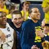 Michigan forward Mitch McGary, center, hugs and reacts with teammates Glenn Robinson III, left, and Jordan Morgan, right, from the bench in the first half of an NCAA college basketball game against Nebraska at Crisler Center in Ann Arbor, Mich., Wednesday, Feb. 5, 2014. (AP Photo/Tony Ding)