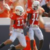Oklahoma State\'s Zac Robinson (11) and Tommy Devereaux (10) celebrate after Robinson\'s rushing touchdown during the first half of the college football game between the Oklahoma State University Cowboys (OSU) and the Texas Tech University Red Raiders (TTU) at Boone Pickens Stadium on Saturday, Sept. 22, 2007, in Stillwater, Okla. By CHRIS LANDSBERGER, The Oklahoman