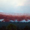 A DC-10 Air Tanker drops fire retardant near home in the evening as the Black Forest Fire continues to burn out of control for a second straight day near Colorado Springs on Wednesday, June 12, 2013. The fire has consumed 11,500 acres. It has destroyed 92 homes and damaged others. The erratic fire has forced the evacuation of thousands of people. (AP Photo/BryanOller)