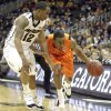 Oklahoma\'s Markel Brown (22) tries to drive past Missouri\'s Marcus Denmon (12) during the Big 12 tournament men\'s basketball game between the Oklahoma State Cowboys and Missouri Tigers the Sprint Center, Thursday, March 8, 2012. Photo by Sarah Phipps, The Oklahoman