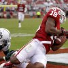 Oklahoma\'s Justin Brown (19) sores a touchdown in front of Baylor\'s Shawn Oakman (2) during the college football game between the University of Oklahoma Sooners (OU) and Baylor University Bears (BU) at Gaylord Family - Oklahoma Memorial Stadium on Saturday, Nov. 10, 2012, in Norman, Okla. Photo by Chris Landsberger, The Oklahoman
