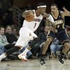 Cleveland Cavaliers\' Daniel Gibson (1) drives past Indiana Pacers\' George Hill (3) during the fourth quarter in an NBA basketball game on Friday, Dec. 21, 2012, in Cleveland. The Pacers won 99-89. (AP Photo/Tony Dejak)