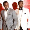 Sean Combs, left, poses with his wax figure at Madam Tussauds in New York, Tuesday, Dec. 15, 2009. (AP Photo/Charles Sykes)
