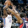 Oklahoma City\'s Jeff Green is pressured by Atlanta\'s Al Horford during their NBA basketball game at the OKC Arena in Oklahoma City on Friday, Dec. 31, 2010. Photo by John Clanton, The Oklahoman