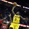 Cleveland Cavaliers\' Dion Waiters (3) shoots over Atlanta Hawks\' Josh Smith (5) in the second quarter of an NBA basketball game, Friday, Dec. 28, 2012, in Cleveland. (AP Photo/Mark Duncan)