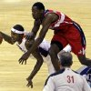 Charlotte Bobcats\' Tyrus Thomas, left, is fouled by Washington Wizards\' Jordan Crawford during the first half of an NBA basketball game in Charlotte, N.C., Tuesday, Nov. 13, 2012. (AP Photo/Chuck Burton)