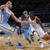 Oklahoma City\'s Reggie Jackson (15) drives the ball past Denver\'s JaVale McGee (34) during the NBA preseason basketball game between the Oklahoma City Thunder and the Denver Nuggets at the Chesapeake Energy Arena, Sunday, Oct. 21, 2012. Photo by Garett Fisbeck, The Oklahoman