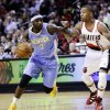 Photo - Denver Nuggets guard Ty Lawson (3) drives inside against Portland Trail Blazers guard Damian Lillard during the first quarter of an NBA basketball game in Portland, Ore., Wednesday, Feb. 27, 2013. (AP Photo/Don Ryan)