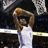 Oklahoma City\'s Serge Ibaka (9) dunks the ball past Charlotte\'s Byron Mullens (22) during an NBA basketball game between the Oklahoma City Thunder and Charlotte Bobcats at Chesapeake Energy Arena in Oklahoma City, Monday, Nov. 26, 2012. Photo by Nate Billings , The Oklahoman