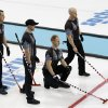 Photo - Canada's, from left, E.J. Harnden, Ryan Harnden, skip Brad Jacobs, and Ryan Fry,  look over they next shot during men's curling competition against Norway at the 2014 Winter Olympics, Friday, Feb. 14, 2014, in Sochi, Russia. (AP Photo/Robert F. Bukaty)