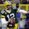 Photo - Green Bay Packers quarterback Aaron Rodgers (12) scrambles during the first half of an NFL wild-card playoff football game against the San Francisco 49ers, Sunday, Jan. 5, 2014, in Green Bay, Wis. (AP Photo/Mike Roemer)