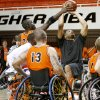The Spokes\' Jason Walley blocks the shot of OSU\'s Marshall Moses during a wheelchair basketball charity game at Gallager-Iba Arena in Stillwater, Okla., Tuesday, April 14, 2009. Photo by Bryan Terry, The Oklahoman