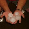Mark Danker holding larger than golf ball sized hail stones Community Photo By: Susan Danker Submitted By: Mark, Chandler