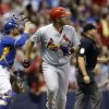 Photo - St. Louis Cardinals' Jhonny Peralta watches his two-run home run against the Milwaukee Brewers during the sixth inning of a baseball game Friday, July 11, 2014, in Milwaukee. (AP Photo/Jeffrey Phelps)