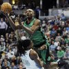 Photo - Boston Celtics forward Jeff Green is called for an offensive foul as he runs into Denver Nuggets forward Kenneth Faried on a shot attempt in the first half of an NBA basketball game on Tuesday, Jan. 7, 2014, in Denver.  (AP Photo/Chris Schneider)