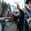 Argentina soccer fans cheer and play drums as they wait for the arrival of their team to Buenos Aires, Argentina, Monday, July 14, 2014. Fans came out to welcome home Argentina\'s team after it was defeated 1-0 by Germany at the Brazil World Cup final match on Sunday. (AP Photo/Daniel Jayo)