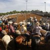 A view from grandstand as contestants crowd behind the center arena for roping and timed events during the morning go-round at the IFYR rodeo on Thursday, July 11, 2013. July 10, 2013. Photo by Jim Beckel, The Oklahoman.