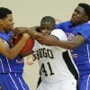 Milloowd\'s Michael Mays, left, and Jamal Green-Gaskins defend Hugo\'s C.J. Scott during a Class 3A boys state basketball tournament game between Hugo and Millwood at Yukon High School in Yukon, Okla., Thursday, March 7, 2013. Photo by Bryan Terry, The Oklahoman