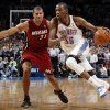 Oklahoma City\'s Kevin Durant (35) drives the ball past Miami\'s Shane Battier (31) during the NBA basketball game between the Miami Heat and the Oklahoma City Thunder at Chesapeake Energy Arena in Oklahoma City, Sunday, March 25, 2012. Oklahoma City won, 103-87. Photo by Nate Billings, The Oklahoman