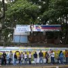 Residents line up at a polling station to vote in presidential elections in Caracas, Venezuela, Sunday, Oct. 7, 2012. President Hugo Chavez is running against opposition candidate Henrique Capriles.(AP Photo/Sharon Steinmann)