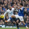 Photo - Everton's Steven Pienaar, right, fights for the ball against Tottenham's Sandro during their English Premier League soccer match at Goodison Park Stadium, Liverpool, England, Sunday Nov. 3, 2013. (AP Photo/Jon Super)